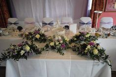 Stunning top table centrepiece with birdcage at the centre