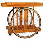 Bicycle-wheel bar cart and chopping block designed in 1964 by California artist Bill W.
