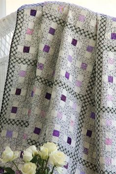 Vintage Violets Quilt -- Love the plaid sashing & the careful placement of the striped fabric within the blocks