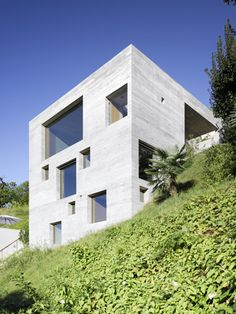 Concrete cube, sitting atop an angled site by Lake Maggiore, is the latest residential offering by Swiss design duo Markus Wespi and Jerome de Meuron.  Photography: Hannes Henzar via *Wallpaper Magazine