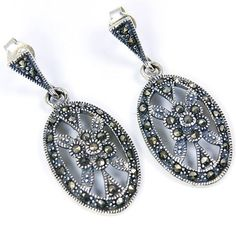 Sterling Silver Marcasite Dangle Earrings The Silver Plaza. $39.95. Trendy Marcasite. Each item is designed and handcrafted by our artisans.. .925 Sterling Silver; Weight: 4.2 grams. Vintage Style Marcasite Dangle Earrings. You are looking at a one of a kind piece, the pictured jewelry will be the same exact piece you'll receive. Marcasite Jewelry, Gemstone Jewelry, Dangle Earrings, Pendant Necklace, Vintage Fashion, Vintage Style, Natural Gemstones, Dangles, Artisan
