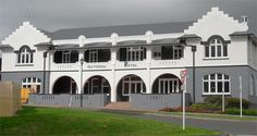National Hotel in Cambridge, New Zealand. Finished in Resene Cod Grey, Resene Shuttle Grey and Resene Hint of Grey. The darker colours use Resene CoolColour techonology,  reducing heat build up in the coating.