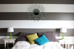 striped accent wall with DIY spray painted mirror...love everything! especially the striped wall :)