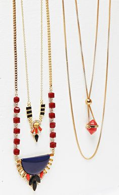 Two-tiered long necklace with tribal-inspired colorful glass stones along a 14k gold plated brass chain.