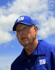 New York Giants head coach Tom Coughlin stands on the field during  NFL football rookie minicamp in East Rutherford, N.J., Friday, May 11, 2012. (AP Photo/Mel Evans)