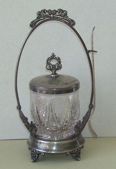 Victorian Quadruple Silver Plate Pickle Castor with Glass Jar. $115.00, via Etsy.
