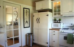 Love how they covered the front of the fridge with these vintage cabinets.