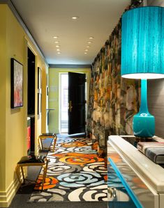 Andrew Suvalsky turquoise entry with Kyle Bunting rug