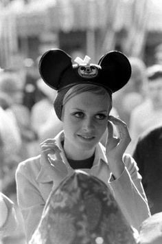 A classic photo of supermodel Twiggy looking divine in a pair of Mickey Mouse ears (via voicesofeastanglia.com)