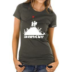 """Banksy Jack & Jill T-shirt – Women's Slim-fit – £15    http://banksyt-shirts.com/banksy-jack-jill-t-shirt-womens-slim-fit/    This design is one of Banksy's highly amusing sticker series. It has also been known as """"Kids With Guns"""" sticker but the Jack & Jill angle is more Banksy… we believe!?    Printed on super soft organic cotton and made to last."""