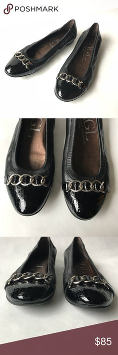AGL Attila Gusti Leombruni Black leather flats AGL Attila Gusti Leombruni Black leather ballet flats. Chain embellishment. Made in Italy. Patent leather toe. Size 7.5. 37.5. Agl Shoes Flats & Loafers