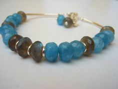 Sterling Silver Bracelet. Faceted Aquamarine and Blue Flash Labradorite.Flower and Gemstone  Charms. SRAJD on Etsy, $36.58