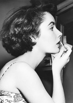 Taking inspiration from Liz Taylor for all holiday cocktail parties: bold brows + red lips. So chic, so timeless. #TBT