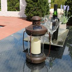 This charming antique finish outdoor hanging solar lantern will add character to any outdoor space. Simply place the outdoor hanging solar lantern in a location with direct sunlight to charge the AA Ni-MH battery. When fully charged the battery can run for up to 8 hours. No electricity or wiring is required, just place the solar lantern in the sun, let it charge then sit back, relax, and enjoy the warm white illumination. Solar Lantern Lights, Solar Hanging Lanterns, Outdoor Hanging Lanterns, Jar Lights, Led String Lights, Solar Chandelier Outdoor, Outdoor Lighting, Mason Jar Pendant Light, Mason Jar Light Fixture