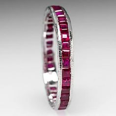 This gorgeous vintage natural ruby eternity wedding band ring features a full circle of princess cut rubies. The ring also features floral engraving details on the sides. This vintage ring is crafted of solid white gold and is previously owned. Antique Wedding Bands, Antique Engagement Rings, Wedding Ring Bands, Antique Diamond Rings, Perfect Engagement Ring, Beautiful Rings, Ruby Wedding, Dream Wedding, White Gold