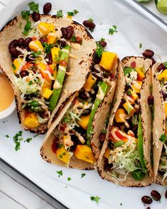 Mango, Black Bean & Avocado Tacos Spicy Mango, Black Bean and Avocado Tacos - The BEST meatless Monday idea! Vegetarian tacos at their finest.Spicy Mango, Black Bean and Avocado Tacos - The BEST meatless Monday idea! Vegetarian tacos at their finest. Veggie Recipes, Mexican Food Recipes, Whole Food Recipes, Cooking Recipes, Healthy Recipes, Healthy Tacos, Avocado Recipes, Quick Recipes, Cooking Fish