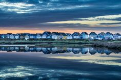 Beach huts reflected in the Lagoon at Mudeford Spit. Mudeford Beach Huts, New Forest, Hampshire, Amazing Photography, Places Ive Been, Seaside, United Kingdom, Around The Worlds, England