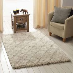 Crafted from durable material with a shaggy pile, this berber rug is finished in a natural colour and available in a range of sizes....