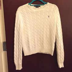 Classic Polo Sweater Excellent condition, this classic white cable-knit sweater is a great staple in any closet. Fitted and comfortable! Polo by Ralph Lauren Sweaters