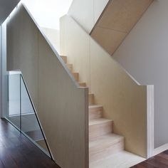 """Residential Architecture: Wakefield Street Townhouses by Piercy & Company: """"..These London townhouses by architectsPiercy & Companyhave chunky banisters formed from thickly layered birch plywood..The stairs zigzag up from the basement floor to the second floor roof terraces of each of the three residences,whicharelocated behind a listed wall within the conservation area of Bloomsbury."""