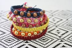 The Alison Show: DIY Hemp Bracelet Tutorial  I love this tutorial! It is so helpful but in stead of using a lobster clasp i tie a wooden bead at the end and just slide it through the loop at the top.