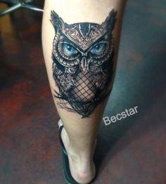 Blue eyes owl tattoo
