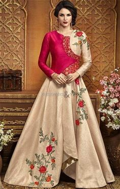 Natural red & beige floor length dress in art silk for stylist girls. It is enhanced with full sleeves, closed back, floral work & surplice neckline for party.