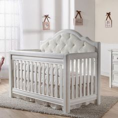 In Stock and 10% off today.  The Cristallo Forever Crib Vintage White with Fabric  Panel from PoshTots