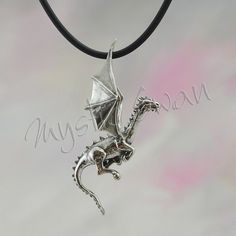 This magical little dragon is the first dragon that I ever designed and still a…