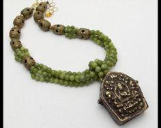 TIBETAN CALENDAR Handcarved Jade Pendant by sandrawebsterjewelry