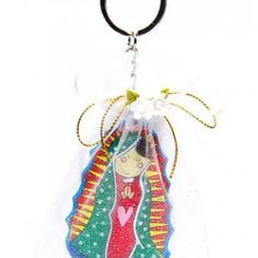 A cartoon image of Our Lady of Guadalupe as key-chain inside a white organza bag handmade party favor for baptism.