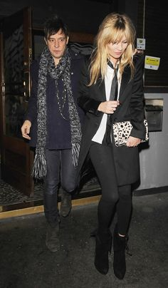 Kate Moss Blazer - Kate dons a coat in blazer style with this black sheen and edgy lapels.