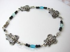 For the turtle lover or just a fan of the beach. A cute Beaded Sea Turtle Anklet in Silver and Aqua Blue  hand crafted with silver filled wire and glass beads. #turtle #handmade jewelry #beach wear