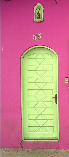 Decorate Wild! (Just make sure you're neighbors are ok with it!). Love a bold colored door.