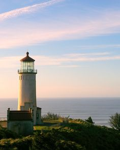 Oregon lighthouse at days end  http://www.oregonbeachvacations.com/