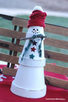 terra cotta pot snowman | Easy Terra Cotta Snowman Tutorial from OneCreativeMommy.com--you'll be ...