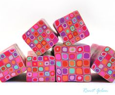 Polymer clay millefiori cane  Red Pinks light blue by RonitGolan