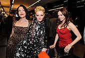 Erin Cummings, Lydia Hearst and Rose McGowan attend the Dolce & Gabbana Terraferma Premiere Event on November 9, 2011 in Beverly Hills, California.