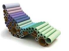 Re-used carpet lounge - how about using the heavy duty cardboard tubes from linoleum and carpet rolls...paint them and assemble!