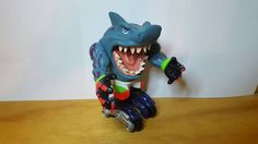 Check out this item in my Etsy shop https://www.etsy.com/listing/484715076/street-sharks-moto-streex-figure-mattel