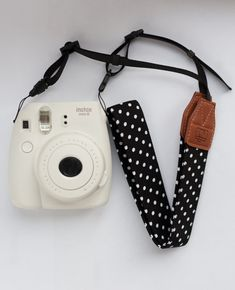 This Instax / Polaroid camera strap is an awesome way to accessorize your instant camera! -Adjustable length -Size: Strap lenght: 70 cm (27.5), width: cm 3.8 cm (1.5)