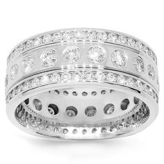 This beautifully designed womens diamond eternity band is crafted in highly gleaming 14K white gold. Round cut diamonds are bezel set all the the across the band and the outside frame on both sides is channel set wtih very small round cut diamonds. The band measures to 5/16 Inches in width and weighs approximately 7.9 grams. This exquisite diamond eternity band is an ideal gift for that special occasion. $2,936.00