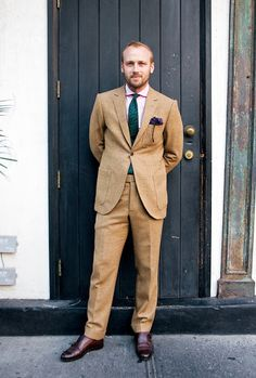 Beige plaid suit, pink shirt, green tie