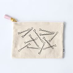 Size: x Natural canvas pouch with sewn tag Gold zipper with pink leather tassel Polka dot fabric liner Interior pocket with zipper Hand-lettered & illustrated Screen-printed in USA Bag Essentials, Bag Illustration, Embroidery Bags, Pencil Bags, Fabric Bags, Fabric Basket, Jute Bags, Handmade Bags, Handmade Leather