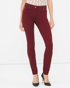 "Just bought these!!!  Fueled by classic denim attitude, our ponte skinnies (in a decadent red velvet color) feature shiny rivets, zip accent and classic jean pockets. In short, you will want to keep this style in heavy rotation. You've been warned. Ponte skinny pants  Rayon/nylon/spandex. Machine wash.   Regular: Approx. inseams: 26.5"" short, 29"" regular, 31"" long   Petite: Approx. 26.5"" inseam    Imported"