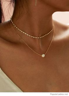 Gold necklaces with a pearl