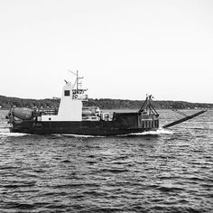 """""""Just passing by.  #exploring #Maine #myMaine #wandering #exploreusa #exploreMaine #exploreAmerica #summer #August #bnw #blackandwhite #daylight #boat #passing #ocean #water #transport #trucks"""" Photo taken by @ndoocy on Instagram, pinned via the InstaPin iOS App! http://www.instapinapp.com (09/04/2015)"""