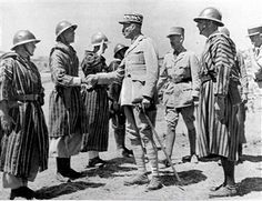 General Giraud of the French Army inspects and congratulates his Goumier troops who distinguished themselves during the Sicilian campaign while fighting under American command. Pin by Paolo Marzioli