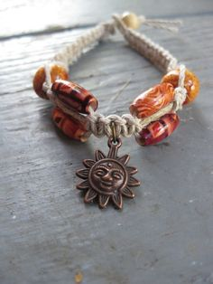 bracelet with beads and a bronze sun as center piece....i love these beads