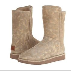 UGG Collection Abree Short Leopard Super Hard to find! Absolutely Gorgeous UGG Collection Abree Short Leopard. Im second guessing myself listing these because I'm in ❤️ with them. But It breaks my heart just letting them sit in my closet. UGG Shoes Winter & Rain Boots